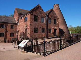 Coalport porcelain - Part of the old factory, now museum, with bottle kiln behind, and the canal running through the works.