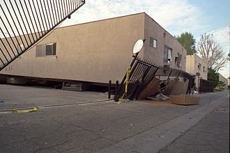 1994 Northridge earthquake - Apartment building that collapsed onto its own footprint, crushing cars parked beneath it