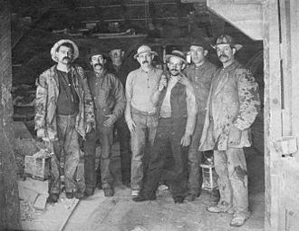 "Comstock Lode - Comstock miners, 1880s. Caption on original: ""To Labor is to Pray."""