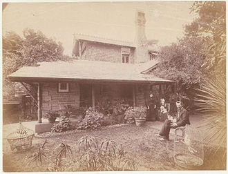 "Cranbrook, Bellevue Hill - John Horbury Hunt outside ""Cranbrook Cottage"" with his wife and daughter"
