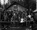 Crew at camp with children and dog, North Bend Mill & Lumber Company, North Bend, ca 1920 (KINSEY 2446).jpeg