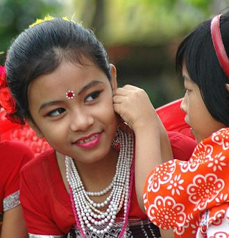 Demographics of India - Tripuri children preparing for a dance performance. The Tripuris, are a Tibeto-Burman ethnic group.