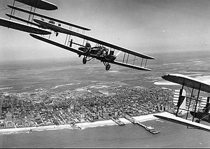 11th Bomb Squadron - Curtiss B-2 Condor formation flight over Atlantic City, N.J. S/N 28-399 is in the foreground (tail section only). Aircraft were assigned to 11th Bombardment Squadron, 7th Bombardment Group at Rockwell Field, California. This flight of 4 aircraft completed cross-country flight to Atlantic City, NJ