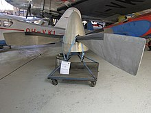 A set of propeller blades, unattached from an aircraft mounting.