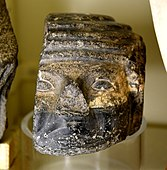 Damaged basalt head of a foreigner, from a door socket. Early Dynastic Period, 1st to 2nd Dynasties. From Thebes, Egypt. The Petrie Museum of Egyptian Archaeology, London.jpg