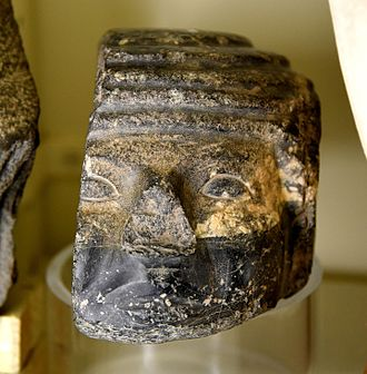 Early Dynastic Period (Egypt) - Damaged basalt head of a foreigner, from a door socket. Early Dynastic Period, 1st to 2nd Dynasties. From Thebes, Egypt. The Petrie Museum of Egyptian Archaeology, London