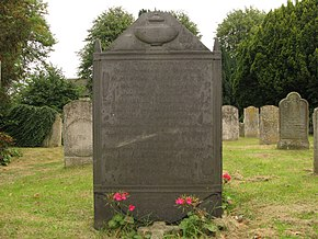 Large gravestone in a churchyard