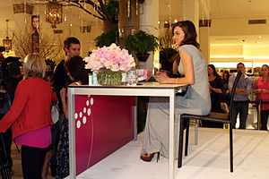 David Jones Limited - Model Miranda Kerr (seated) at a David Jones book signing in Sydney. Kerr was the spokesperson of the company from 2008 until 2013.