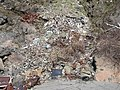 Debris dumped down a cliff onto gravel bank of Klamath River (3906944744).jpg