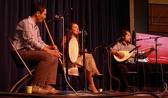 Turkish folk music - Left to right: Unidentified flautist, vocalist Derya Baykent and baglama player Hakan Öktem.