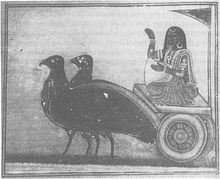 A grey-scale image depicting woman wearing a sari and gold ornaments siting on a chariot pulled by two large black birds and holding a winnowing basket.