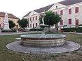 Dolomieu - Fontaine, monument aux morts et école primaire.jpg