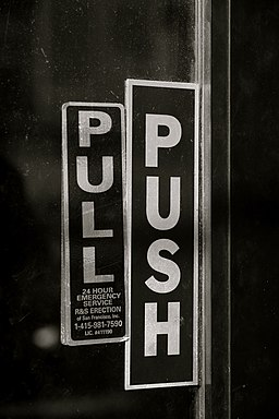 Door with both push and pull signs