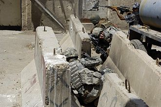 Jersey barrier - Soldiers taking cover from enemy fire behind Jersey barriers in Baghdad, Iraq, 2007