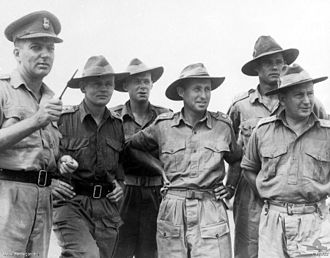 Ivan Dougherty - Officers of the 21st Infantry Brigade. Left to right: Brigadier I. N. Dougherty NX148, Commanding Officer (CO) 21st Infantry Brigade; Lieutenant Colonel F. H. Sublet WX1598 CO, 2/16th Infantry Battalion; Major L. E. Walcott NX34843, Brigade Major; Lieutenant-Colonel P. E. Rhoden 3129001, CO 2/14th Infantry Battalion; Lieutenant Colonel A. C. Sharp CO, 2/6th Field Ambulance; and Lieutenant Colonel K. S. Picken VX48 CO, 2/27th Infantry Battalion.