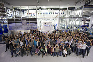 SpaceX - SpaceX employees with the Dragon capsule at SpaceX HQ in Hawthorne, California, February 2015.