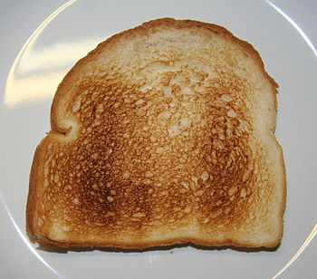 English: Two slices of electrically toasted wh...