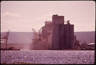 Cargill - Dust fills the air as ships are loaded from a Cargill grain elevator in Duluth, Minnesota, 1973