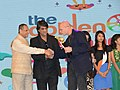 E.S.L. Narasimhan presenting the Best Director Award to Mr. Jury Feting (Russia) at the concluding session of 19th edition ICFFI, at Shilpa Kala Vedika, in Hyderabad. The Chairman-CFSI, Shri Mukesh Khanna is also seen.jpg