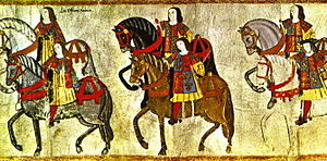 College of Arms - Officers of the College of Arms riding in procession to the Westminster Tournament, from a tourney roll, made during the reign of King Henry VIII in 1511. The pursuivants to the left are identified by their reversed tabards, while the figure in the right (with the black hat) is probably Garter King of Arms Sir Thomas Wriothesley.