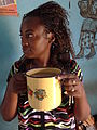 Enid Sips Sorghum Beverage - In Her Home Village - Outside Kabale - Southwestern Uganda (7622598638).jpg