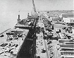 Escort carriers fitting out at Kaiser Shipyards, circa in April 1944.jpg