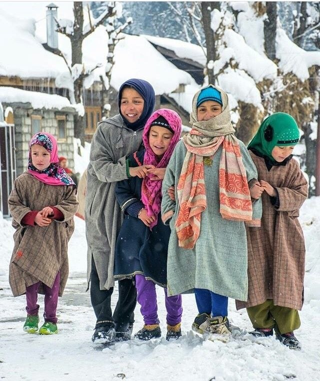 Ethnic Kashmiri girls in traditional pheran