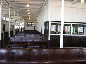 Eureka (ferryboat) - View of the seating area on Eureka's upper deck. The magazine shop is visible to the right behind the glass. The restaurant was on this level at the far end of the deck
