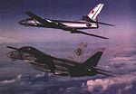 F-14A of VF-102 with Tu-16 in 1985.jpg