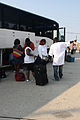 FEMA - 37760 - Evacuees leave busses to check in at the airport to leave Louisiana.jpg