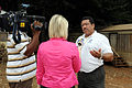 FEMA - 42068 - FEMA PIO with news crew at disaster site.jpg