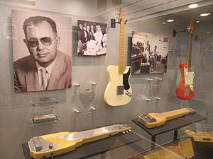 Fender Musical Instruments Corporation - Leo Fender and early guitar models at the Fender Guitar Factory Museum.
