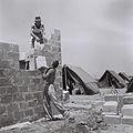 FOUNDING MEMBERS OF MOSHAV BATZRA BUILDING THE FIRST SOLID HOUSE ON THE SITE. חברי מושב בצרה בשרון בונים את בית האבן הראשון במושב.D840-043.jpg