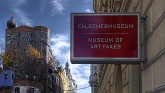 Museum of Art Fakes - Museum of Art Fakes. Background left: the Hundertwasserhaus.