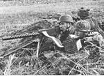 Fallschirmjäger soldiers with M1919 Browning machine gun, 1944.jpg