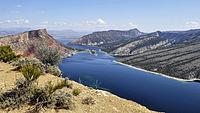 Wide river with sloped landscape on both sides,