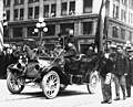 "Former president Theodore Roosevelt, head of the ""Bull Moose"" party, standing in an automobile during a parade, Seattle (CURTIS 983).jpeg"