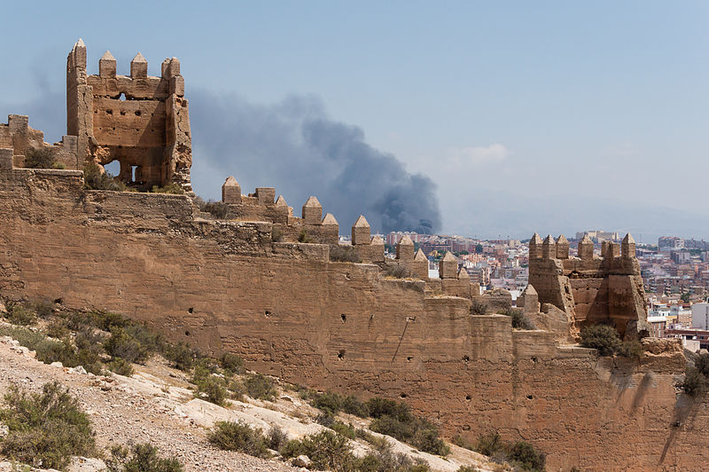 File:Fortification, fire in background, Almeria, Spain.jpg
