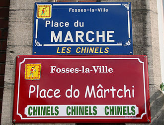Langues d'oïl - Bilingual street sign for market square in French and Walloon