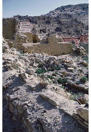 Ganden Monastery - 1985 photo of a portion of Ganden Monastery ruins (with some new buildings) destroyed by the People's Liberation Army in 1959, after Tibetan's March 10th Lhasa protest and the flight to exile of the 14th Dalai Lama of Tibet.