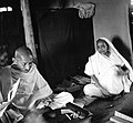 Gandhi and Kasturba seated.jpg