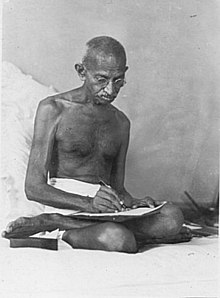 Gandhi writing.jpg
