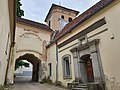 Gate and belfry of the Holy Trinity Church in Vilnius, Lithuania, 2021.jpg