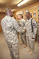 Gen. Austin presents coins to outstanding soldiers on COB Delta DVIDS445769.jpg