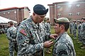 Gen. Ray Odierno presenting an Army Commendation Medal with V device and a Purple Heart Medal to Staff Sgt. Andrew Wood.jpg