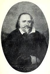 Художественное изображение мужчины, смотрящего прямо из картины, с темными залысинами и острой бородой.  На нем темная одежда с широким белым воротником.