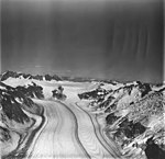 Gilkey Glaciers, hanging glaciers and icefall feeding into valley glacier with band ogives and dark moraines, August 31, 1977 (GLACIERS 6342).jpg
