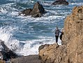 Girl standing on a rock at Glass Beach, Fort Bragg, California (31192198034).jpg
