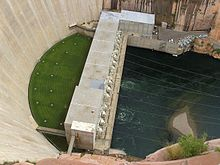 Top view of the Glen Canyon power plant. The dam is to the left, with a grassy lawn between the structures.
