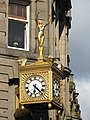 Golden naked woman, and clock - geograph.org.uk - 873664.jpg